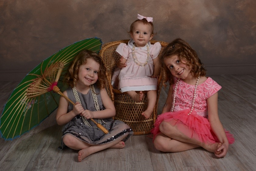 professional photograph of young girls with props at andrae michaels portrait studios in colorado springs