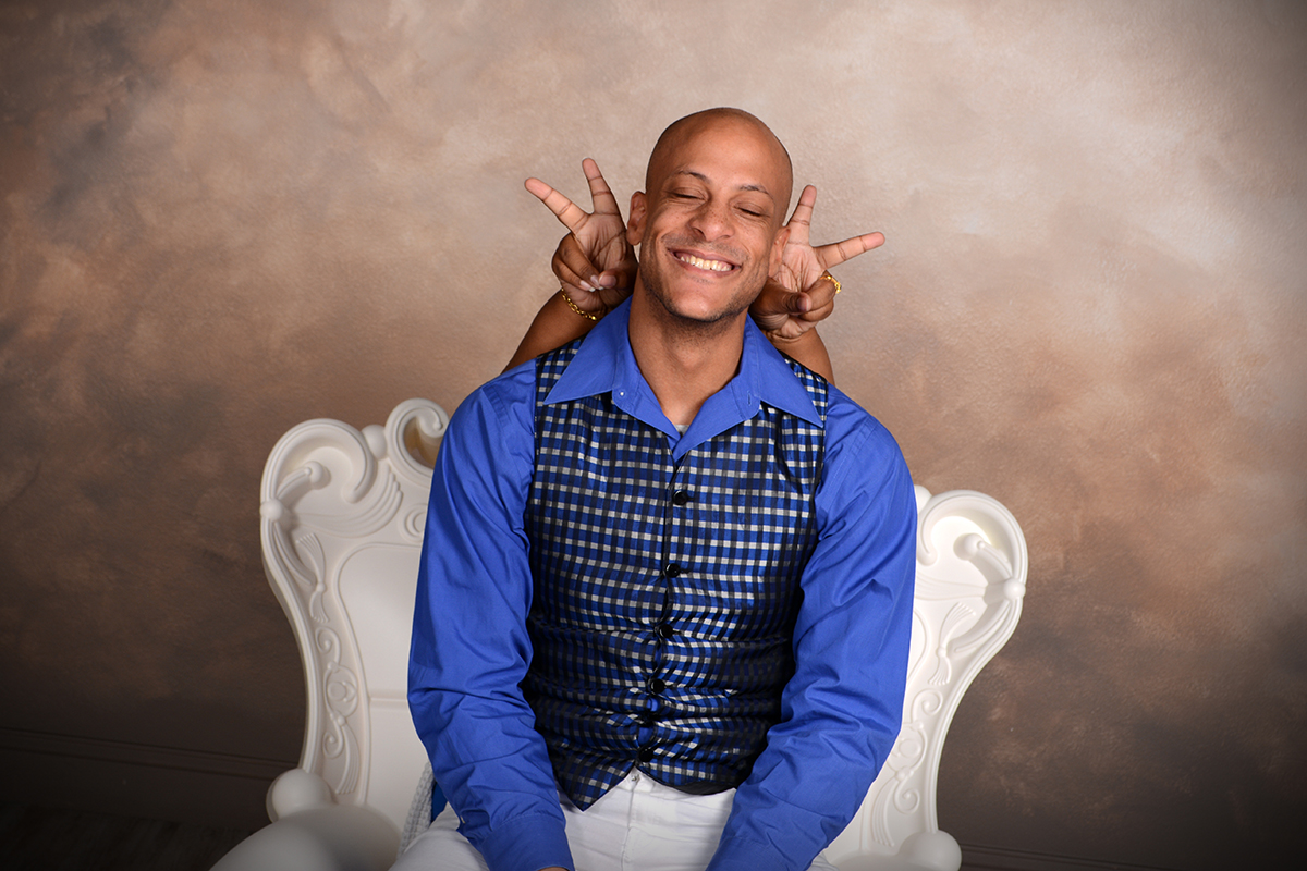 the cartwrights are photographed being silly at andrae michaels portrait studios in colorado springs
