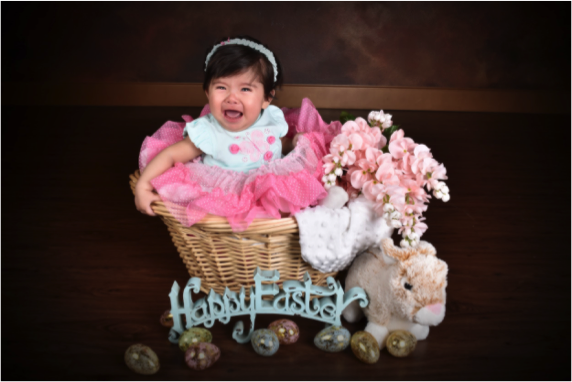 portrait of baby girl laughing by Andrea Michaels portrait studios in Colorado Springs