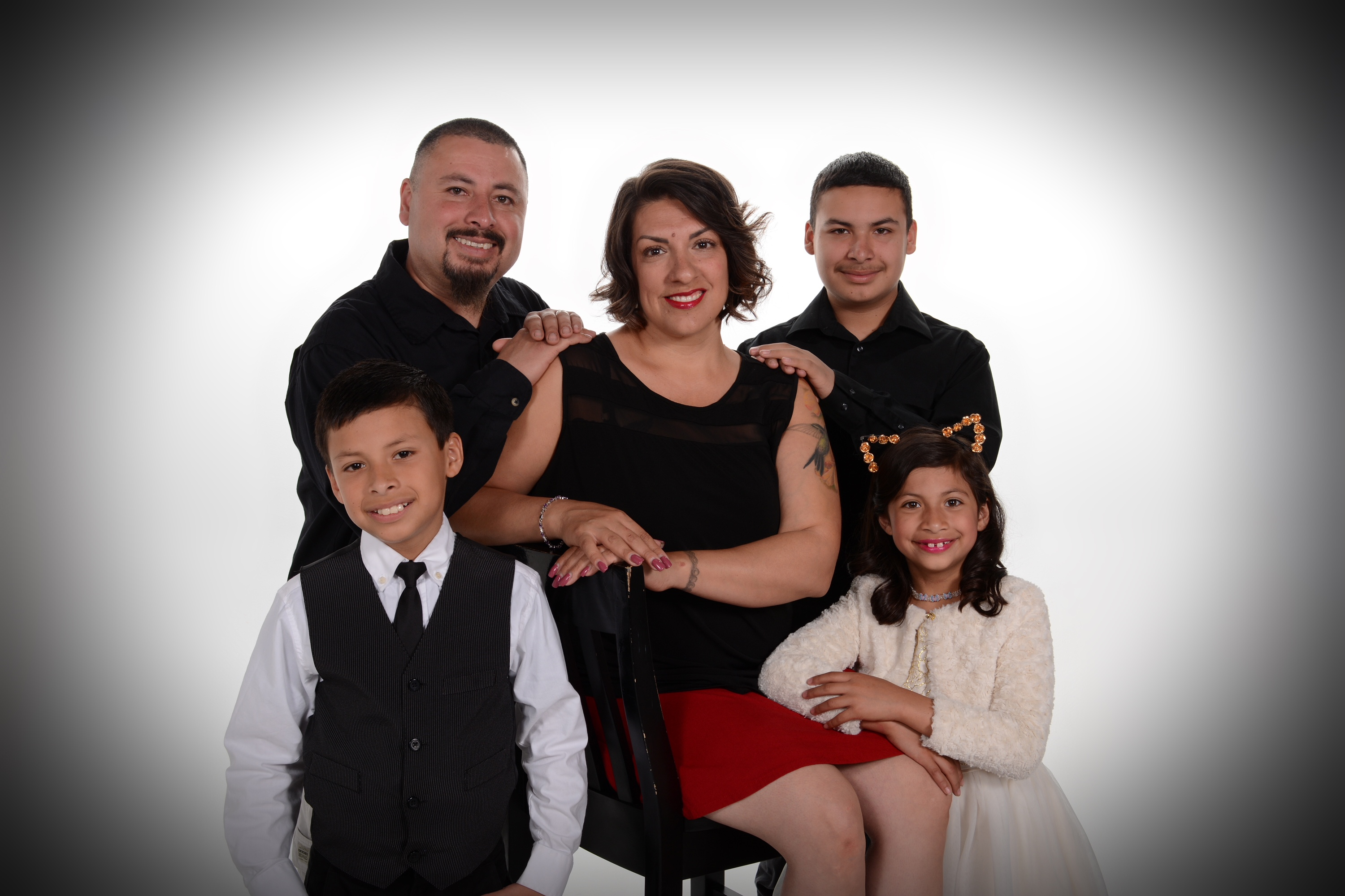 large family poses for professional portrait by Andrea Michaels in Colorado Springs
