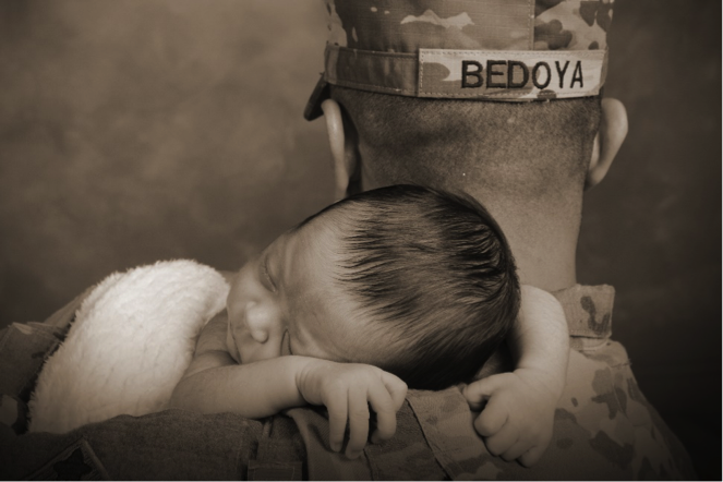 professional portrait of military father holding newborn child Andrae Michaels